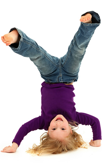 Child doing a handstand.